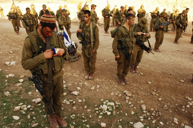 IDF Spokesperson - soldier praying with unit