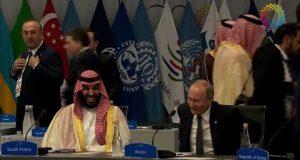 سعادة بن سلمان بمصافحة بوتين